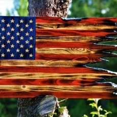 Charred Torn Wooden American Flag